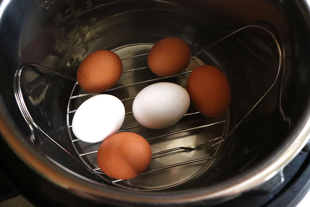 Instant Pot Hard Boiled Eggs made with Farm Fresh Eggs | HomemadeandHappy.com